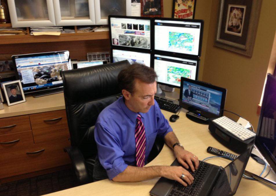 Paul Douglas working at his desk
